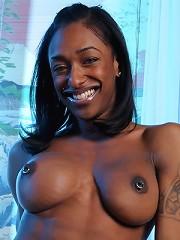 Alluring ebony TS Natalia Coxxx enjoying music naked