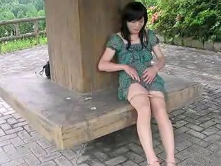 Miss Ayako Masturbates In A Public Park In A Green Dress